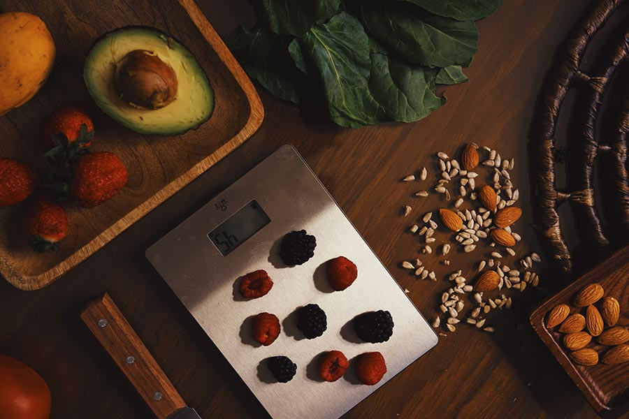 Canva - Scales with berries and organic ingredients for recipe